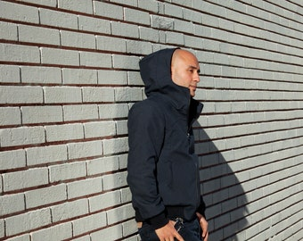 WATERPROOF BOMBER JACKET/Black warm-up jacket/ Bomber with hood and collar/ Pockets and zipper/ Winter bomber