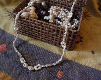 Vintage 37 Inch White and Brown Spotted Momi Lei Necklace