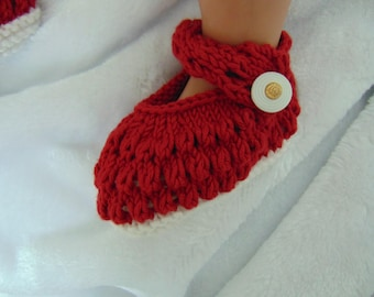 Hand knitted red and white baby shoes