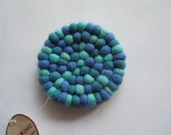 Small hand-felted coasters