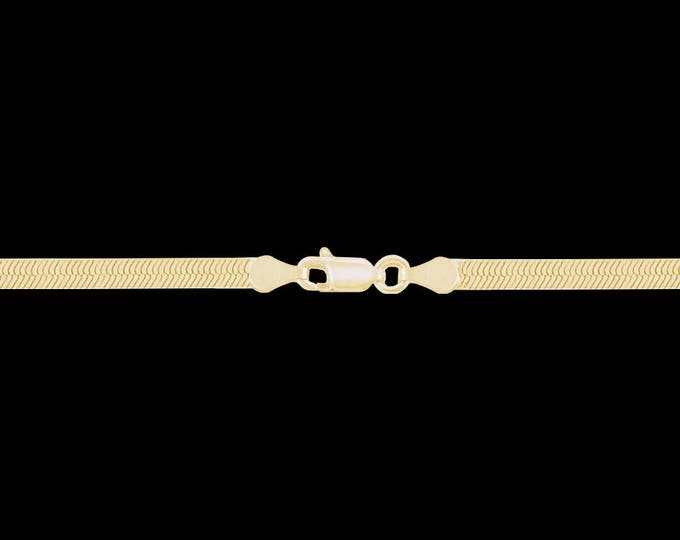Herringbone chain bracelet in 10k yellow gold, 7.80mm, lobster claw clasp; 7, 8, or 9 inches.