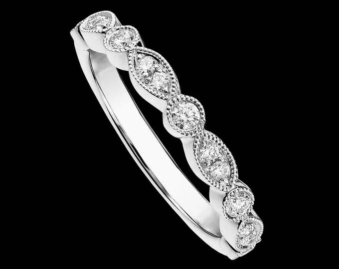 Modern diamond motif wedding ring in 14k gold or platinum (1/5 tcw, H-I color, SI1-SI2 clarity).