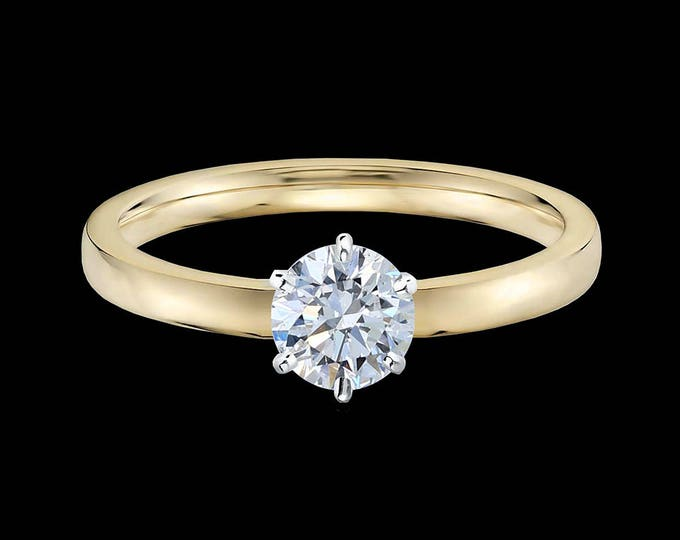 Lewi's 1/2 carat GIA certified diamond engagement ring in 18k yellow gold and 950 platinum prongs.