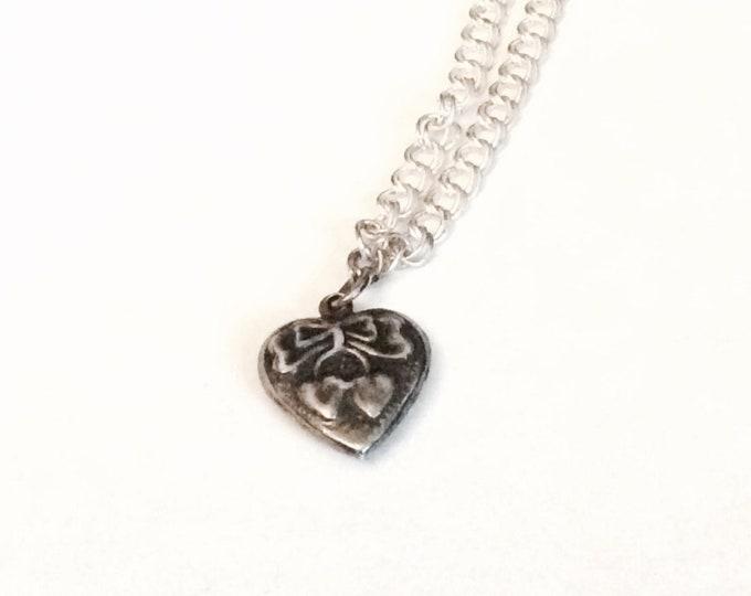 "Antique sterling silver art nouveau bowtie-heart charmed 7"" curb chain bracelet, spring clasp"