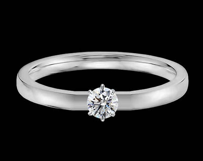 Lewi's 1/4 carat GIA certified diamond engagement ring in platinum.