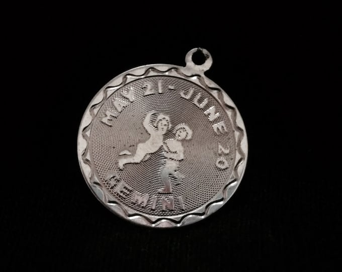 A 1950's Gemini Charm-Pendant Inscribed ' May 21st - June 20th ' , Ornate Art Nouveau Design, 1x.75x.08, 2.33 Grams #3327