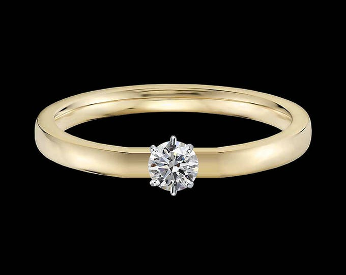 Lewi's 1/4 carat GIA certified diamond engagement ring in 18k yellow gold and 950 platinum prongs.