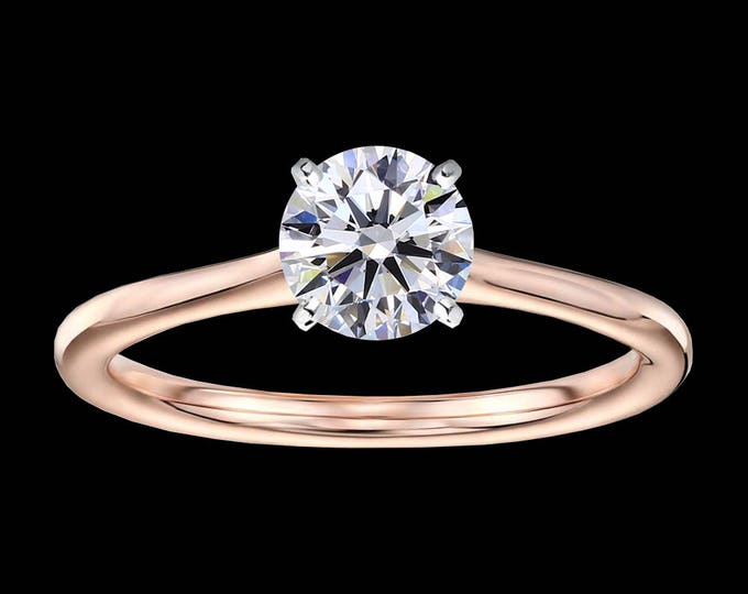 1.00 carat, D color, Ideal cut, IF clarity, GIA certified diamond in gold or platinum.