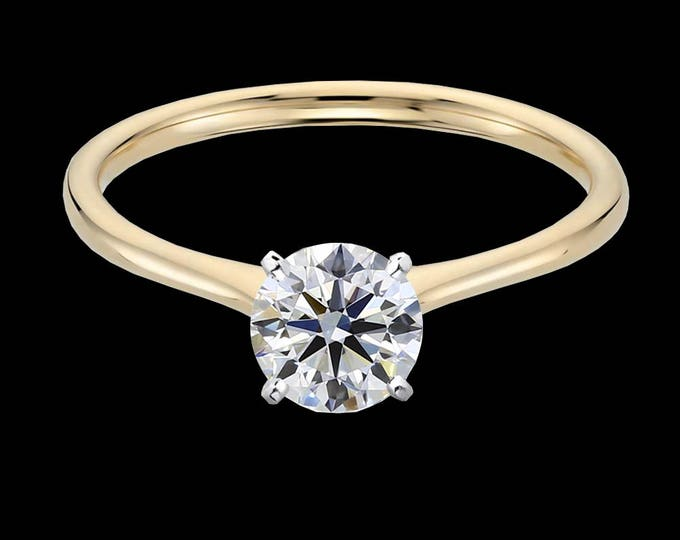 1.00 carat, G color, Ideal cut, VVS1 clarity, GIA certified diamond in gold or platinum.