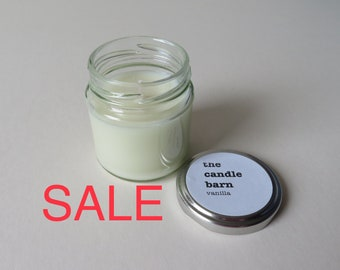 Vanilla scented candle in a small silver screw top glass jar,