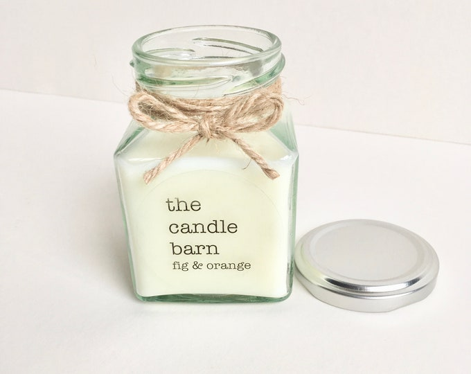 Soy wax scented candle in a square glass jar, with a large range of  scents to choose from