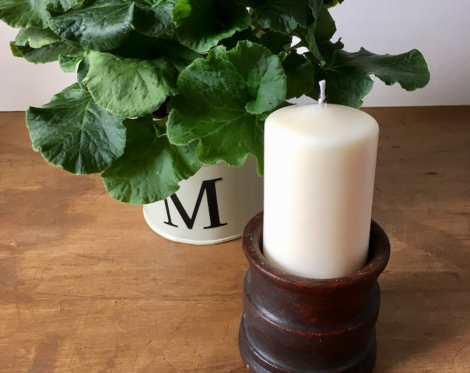 A pair of small unscented soy wax round pillar candles