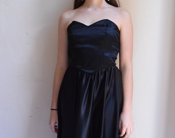 Black Satin Strapless Dress.