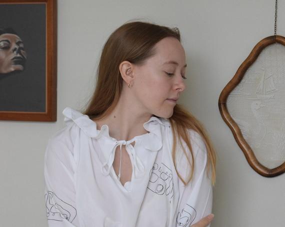 Reina White Drawstring Ruffle Neckline Blouse