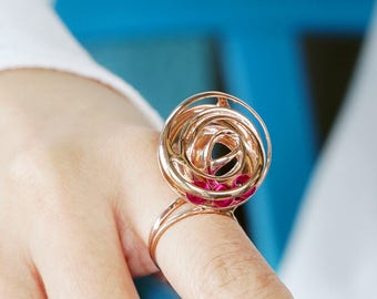 Armillary Kinetic Ring, rolling rubies with every movement of the wearer, sterling silver with ruby, modernist jewellery, Vulcan Jewelry
