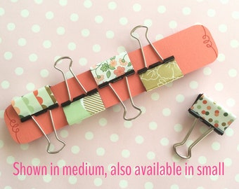 Binder clips in coral, gold, mint green & white. Patterns include floral and spots. 19 and 32mm foldback clips
