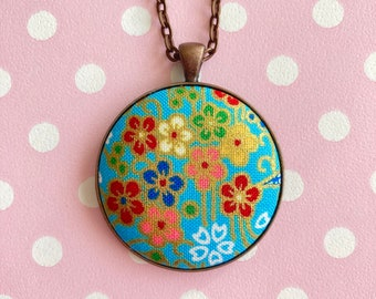 Blue Japanese fabric pendant necklace with flowers and gold printed outlines