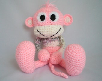 Hand knitted cheeky monkey cuddly toy