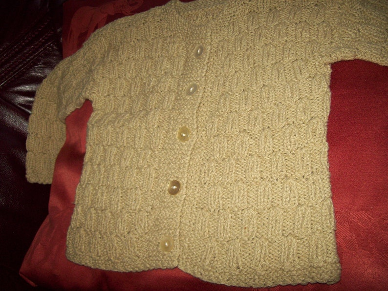 A Vintage hand knitted girls cardigan