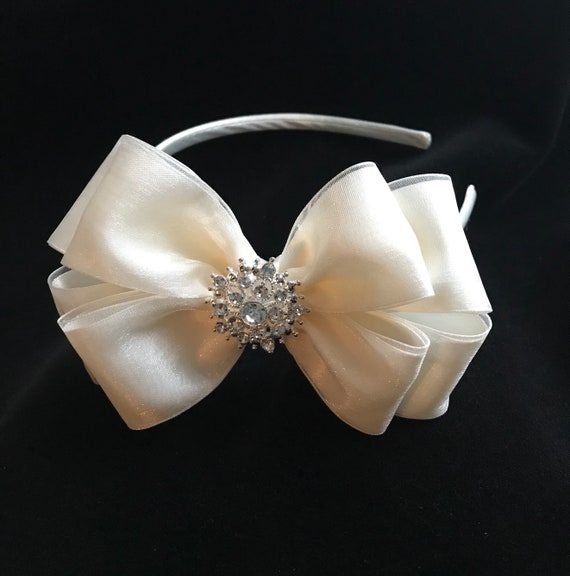 Red and white flower girls hair bow with purple satin flower centre handmade