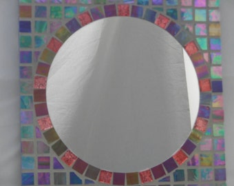 Beautiful multi colored iridescent mosaic tile mirror.