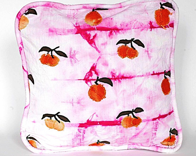 Piped Cushion with Orange Patches on Pink Linen