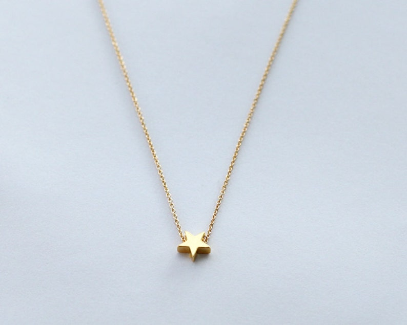 gold star necklace mini 14k gold plated star necklace tiny image 0