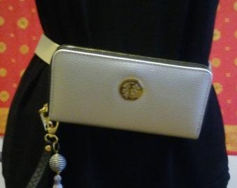 metallic fanny pack with tassel