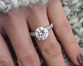 Elegance Pave Round Solitaire Faux Diamond Replica Engagement Ring. Perfect substitution for any diamond band. Sparkle with cubic zirconia