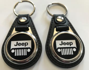 Jeep 2 pack of keychains black and white set.