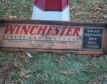 Antique style Winchester Rifles and Shotguns Sign with wood frame