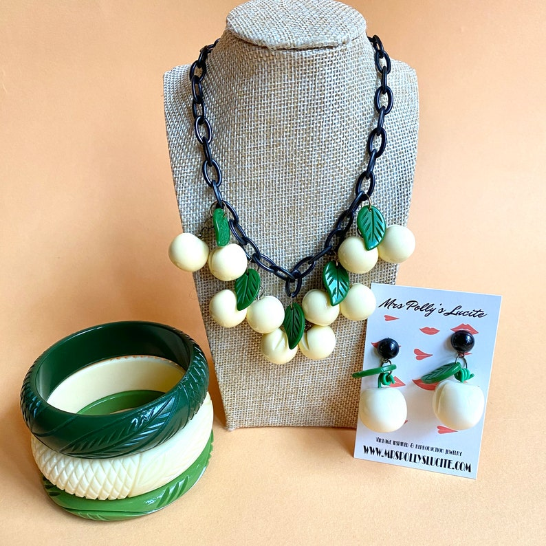 1940s Costume Jewelry: Necklaces, Earrings, Brooch, Bracelets Dreamland necklace and earrings - FUN FAKELITE - Vintage 1940s 1950s Bakelite inspired reproduction - Cream Cherries and green leaf $14.10 AT vintagedancer.com