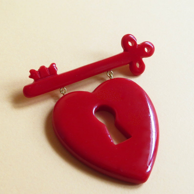 1940s Jewelry Styles and History Key to My Heart brooch Bakelite Vintage Reproduction FUN FAKELITE