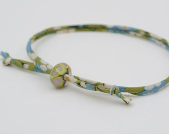 Liberty cord bracelet with handmade green and lilac glass bead