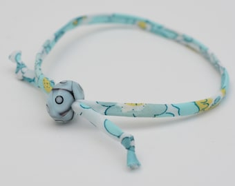 Liberty cord bracelet with handmade pale turquoise and black glass bead