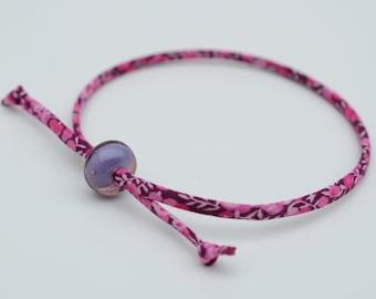Liberty cord bracelet with handmade encased purple glass bead