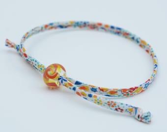 Liberty cord bracelet with handmade yellow and orange glass bead