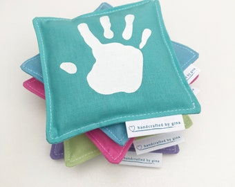 Pocket hand warmers with screen printed hand print