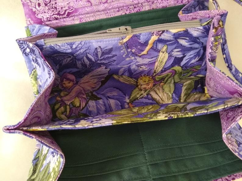 Magical Fairies adorn this accordionexpandable wallet!