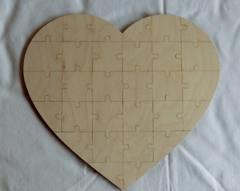 Wood puzzle for wedding and birthdays as a game or to present a gift together