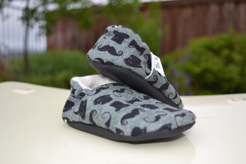 b6c232957a12b Mustache and top hat non slip soft sole shoes. Sizes newborn, baby,  toddler, little kid.