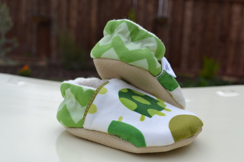 f7580d779c46d Green baby turtle non slip soft sole shoes. Sizes newborn, baby, toddler,  little kid.
