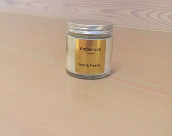 Pear & Freesia Candle with a silver lid