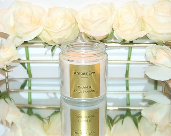 Orchid & Lotus Blossom Candle with a silver lid