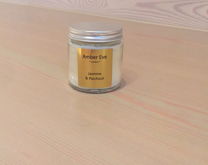 Jasmine & Patchouli Candle with a silver lid