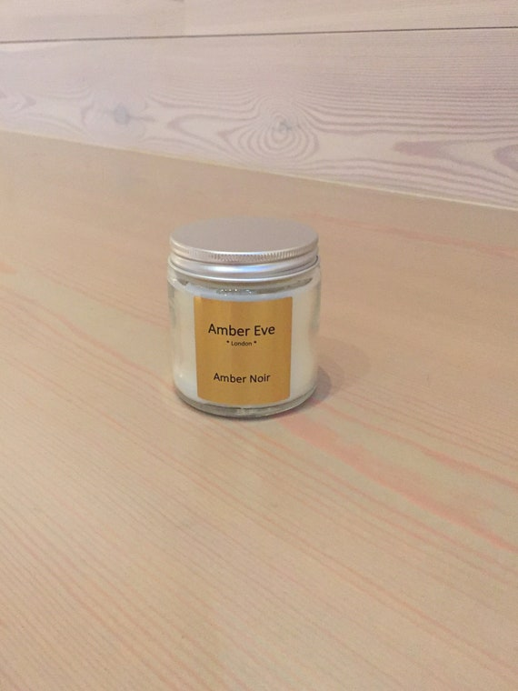 Amber Noir Candle with a silver lid