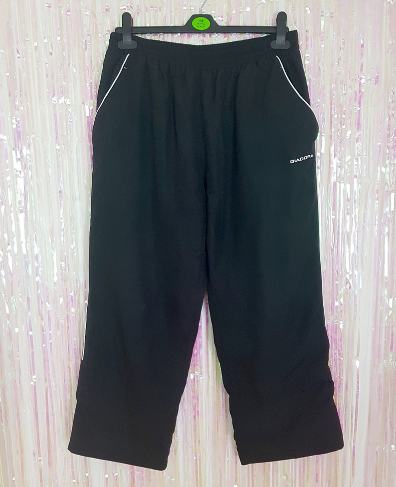 d8e77232 Diadora black high waisted cropped track pants, size large/14/16, Y2k, 00s