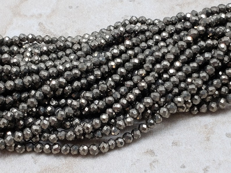 2mm Pyrite Faceted Round Beads 15 inch image 0