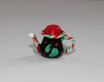 Hot peppers on this Christmas candy inspired teapot