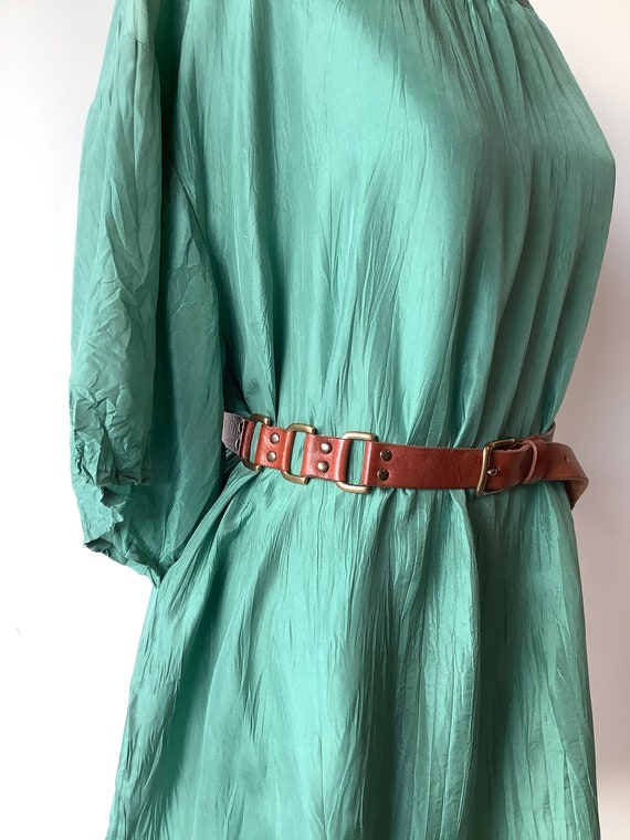 Narrow leather belt with brass belt buckle thin le